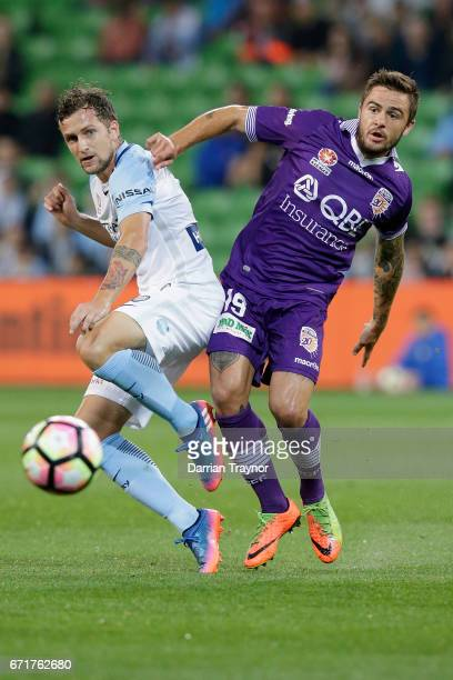 Nicolas Colazo of Melbourne City and Josh Risdon of Perth Glory compete fior the ball during the ALeague Elimination Final match between Melbourne...