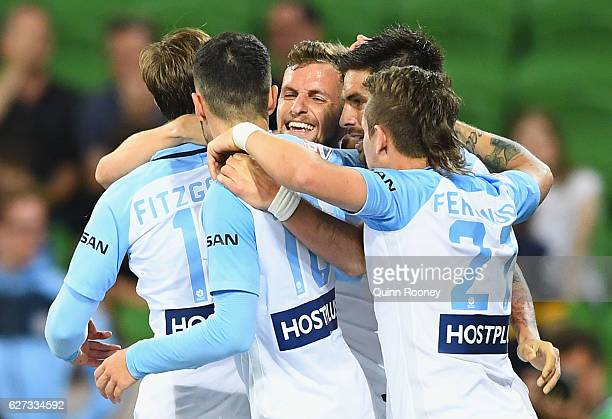 Nicolas Colazo of Melbourne City is congratulated by team mates after scoring a goal during the round nine ALeague match between Melbourne City FC...