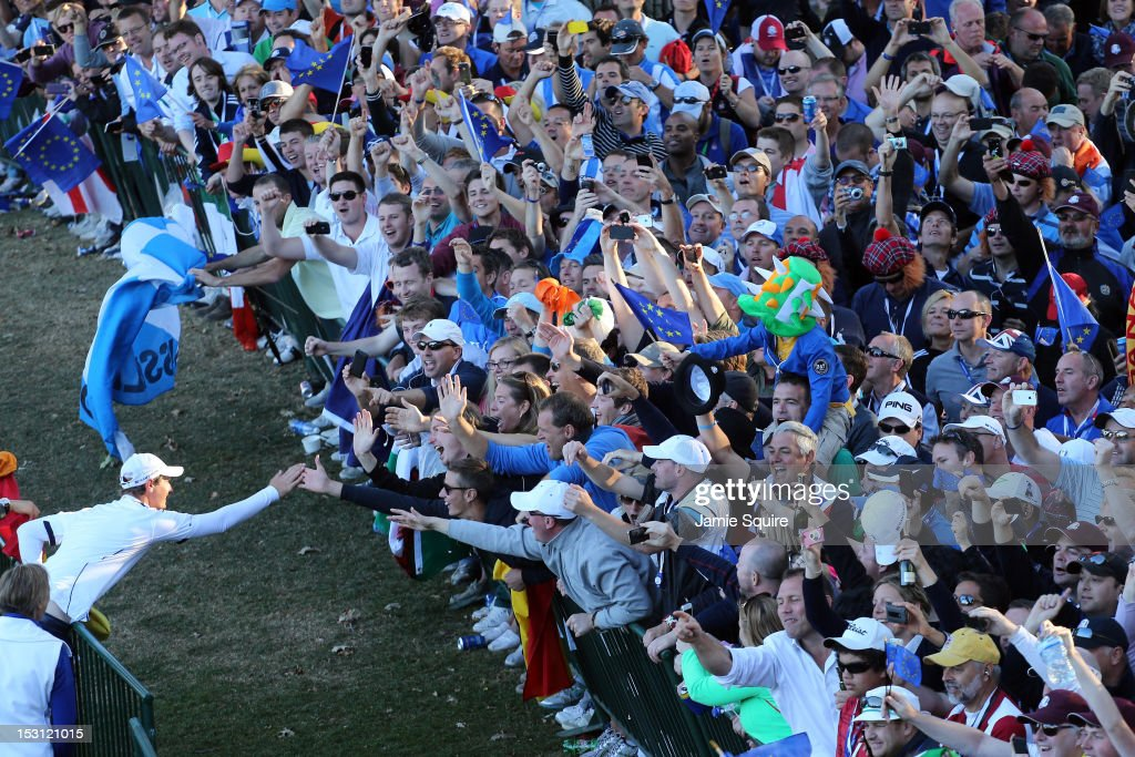 Nicolas Colsaerts celebrates with fans after Europe defeated the USA 145 to 135 to retain the Ryder Cup during the Singles Matches for The 39th Ryder...