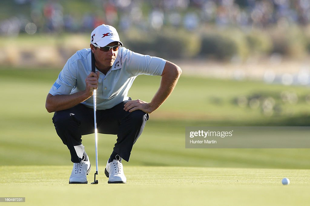 Nicolas Colsaerts lines up his putt on the 18th hole during the second round of the Waste Management Phoenix Open at TPC Scottsdale on February 1, 2013 in Scottsdale, Arizona.