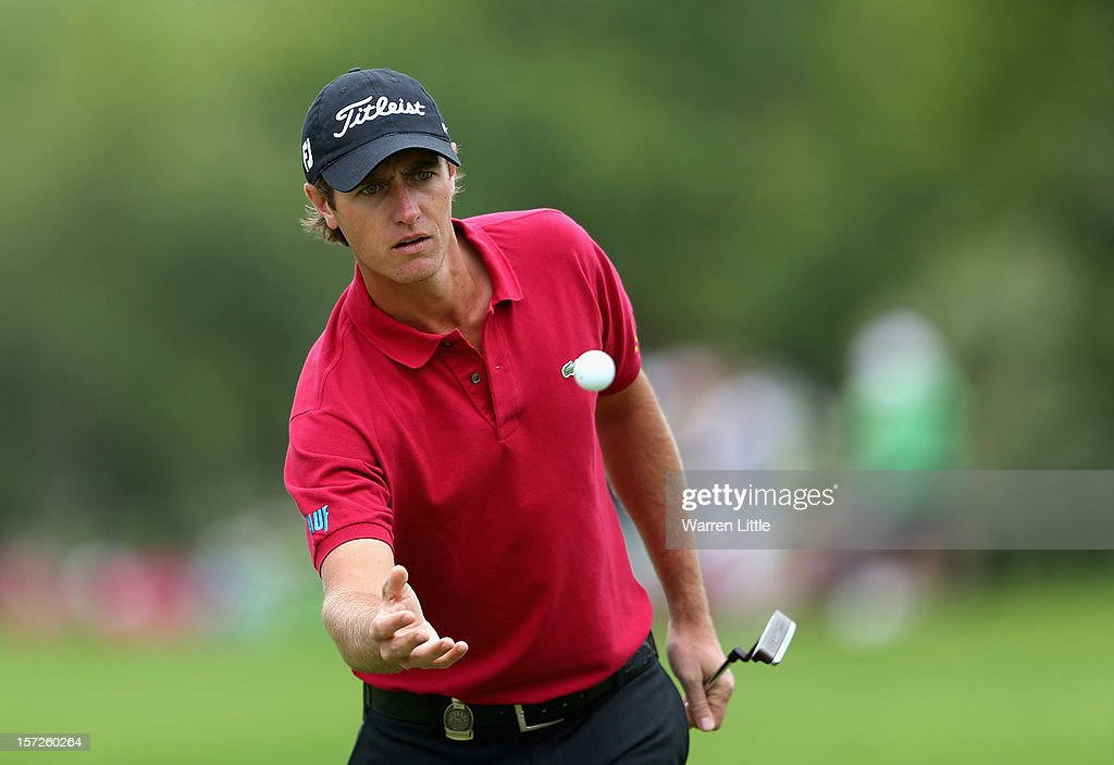 Nicolas Colsaerts of Belgium catches his ball during the third round of the Nedbank Golf Challenge at the Gary Player Country Club on December 1, 2012 in Sun City, South Africa.