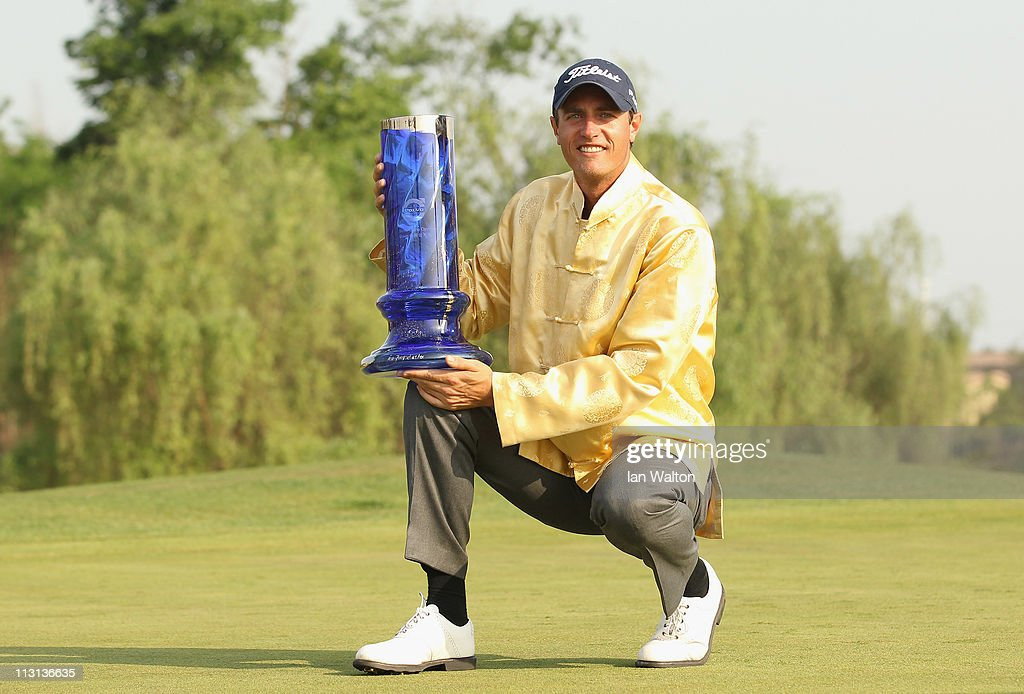 Nicolas Colsaerts of Belgium celebrates with the trophy after winning the Volvo China Open at Luxehills Country Club on April 24 2011 in Chengdu China
