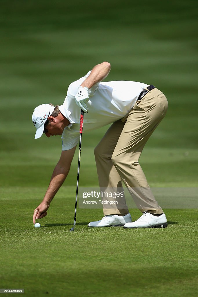 <a gi-track='captionPersonalityLinkClicked' href=/galleries/search?phrase=Nicolas+Colsaerts&family=editorial&specificpeople=216573 ng-click='$event.stopPropagation()'>Nicolas Colsaerts</a> of Belgium checks his lie on the 4th hole during day one of the BMW PGA Championship at Wentworth on May 26, 2016 in Virginia Water, England.