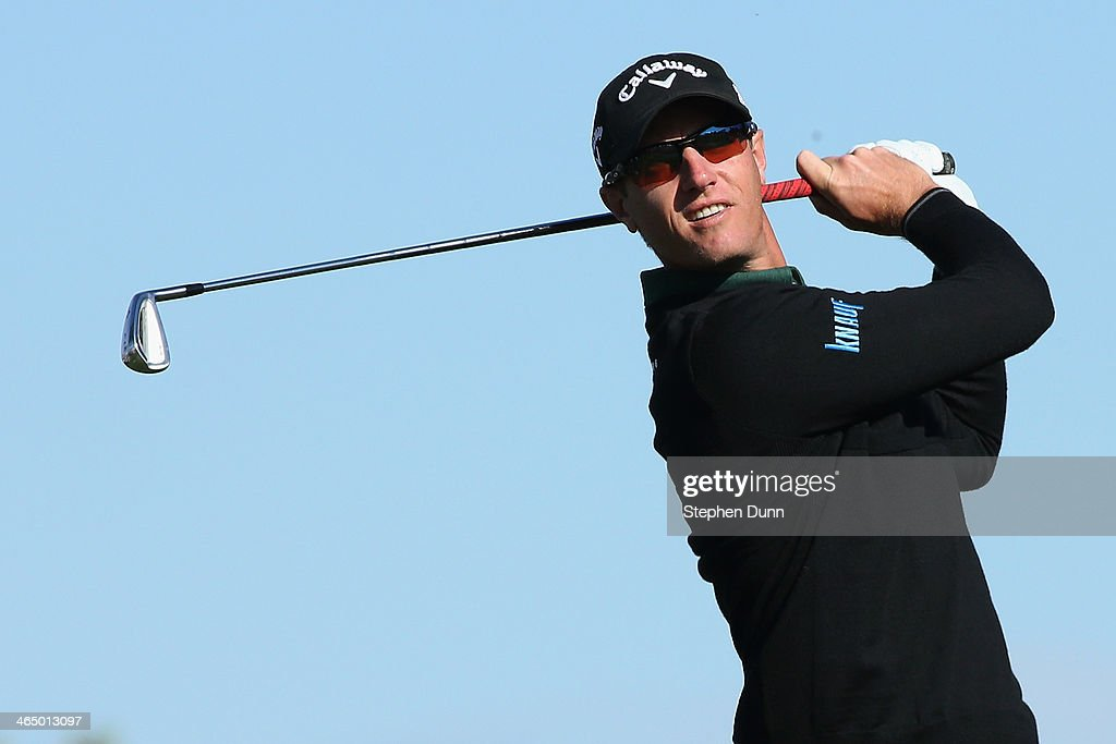 Nicolas Colsaerts of Belgium hits a tee shot on the 2nd hole during the third round of the Farmers Insurance Open on Torrey Pines South on January 25...