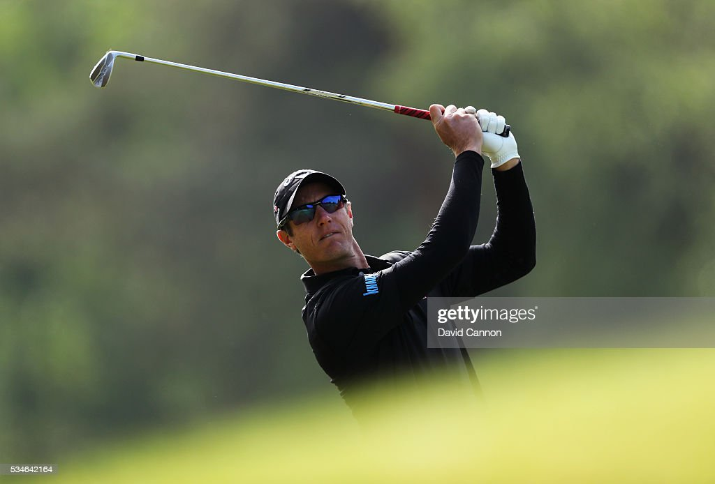 <a gi-track='captionPersonalityLinkClicked' href=/galleries/search?phrase=Nicolas+Colsaerts&family=editorial&specificpeople=216573 ng-click='$event.stopPropagation()'>Nicolas Colsaerts</a> of Belgium hits his 2nd shot on the 9th hole during day two of the BMW PGA Championship at Wentworth on May 27, 2016 in Virginia Water, England.