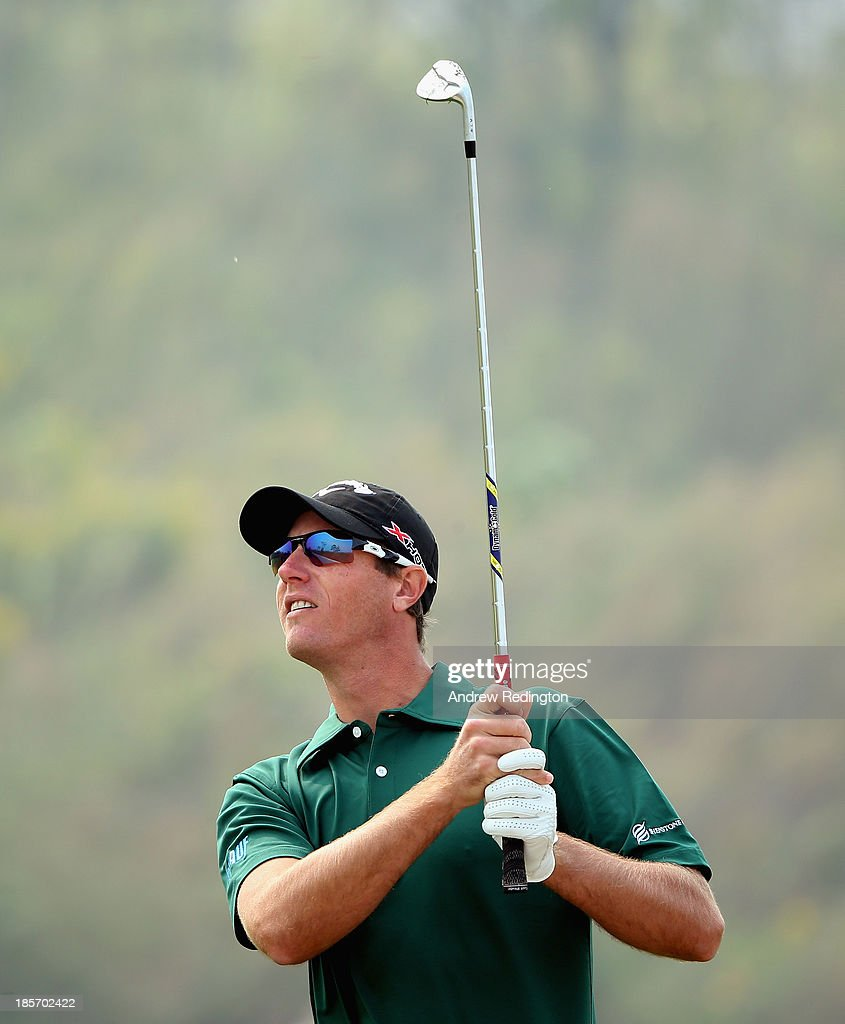 Nicolas Colsaerts of Belgium in action during the first round of the BMW Masters at Lake Malaren Golf Club on October 24, 2013 in Shanghai, China.
