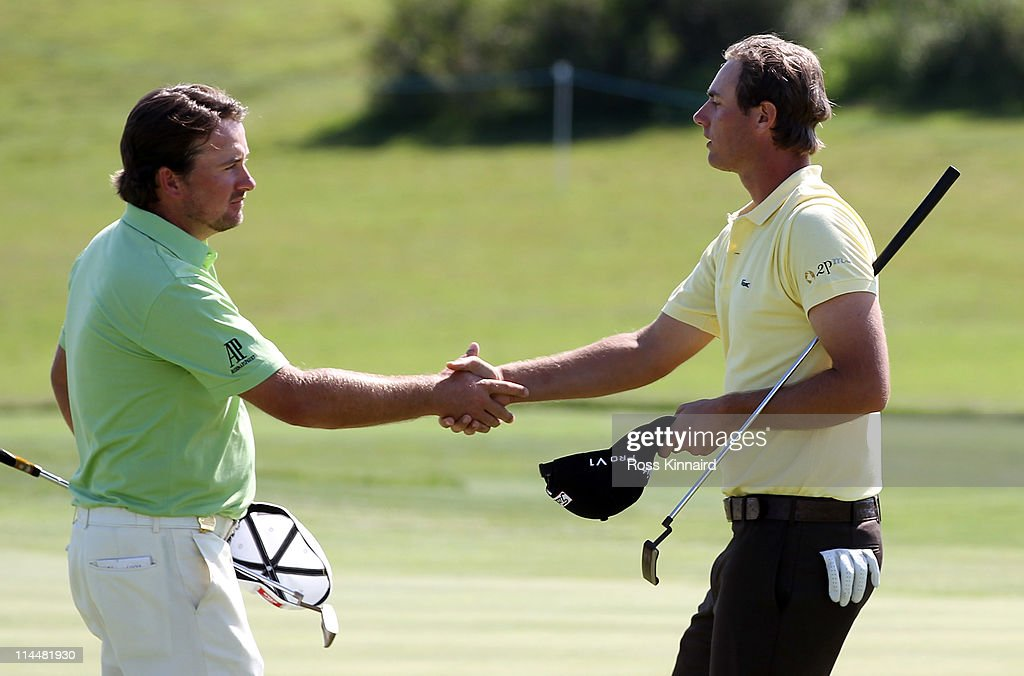 Nicolas Colsaerts of Belgium is congratulated by Graeme McDowell of Northern Ireland after his quarter final match of the Volvo World Match Play...