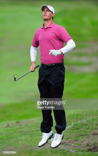 Nicolas Colsaerts of Belgium jumps to see a shot during the first round of The KLM Open Golf at The Hillversumsche Golf Club on September 9 2010 in...