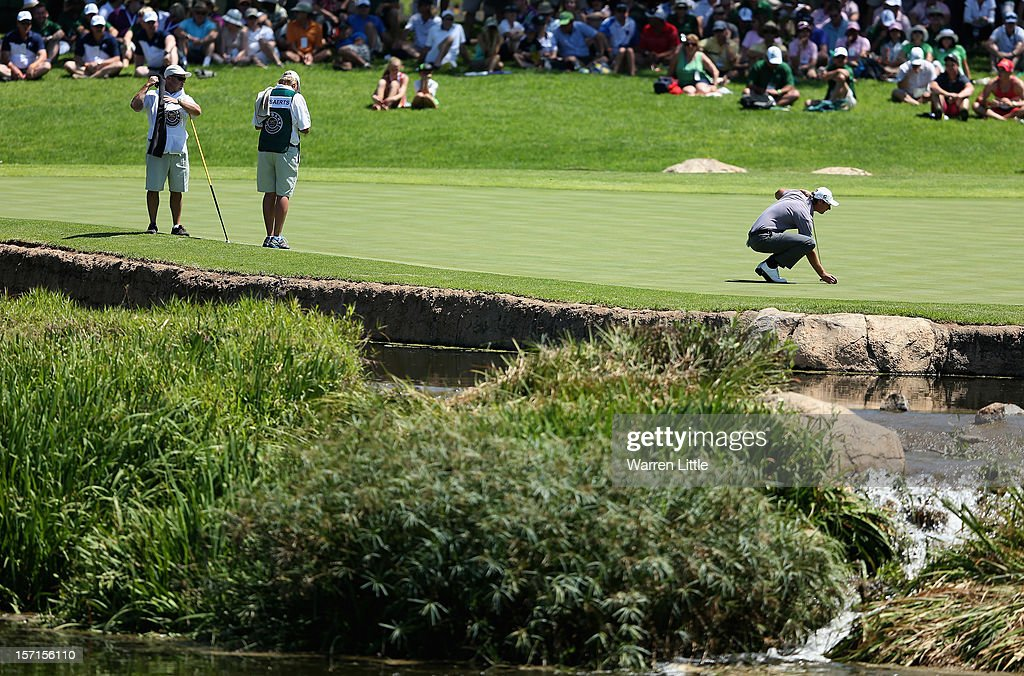 Nicolas Colsaerts of Belgium lines up a putt on the ninth green during the first round of the Nedbank Golf Challenge at the Gary Player Country Club on November 29, 2012 in Sun City, South Africa.