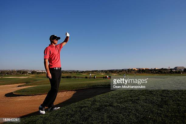 Nicolas Colsaerts of Belgium lines up his second shot on the 12th hole during the first round of the Portugal Masters at Oceanico Victoria Golf...