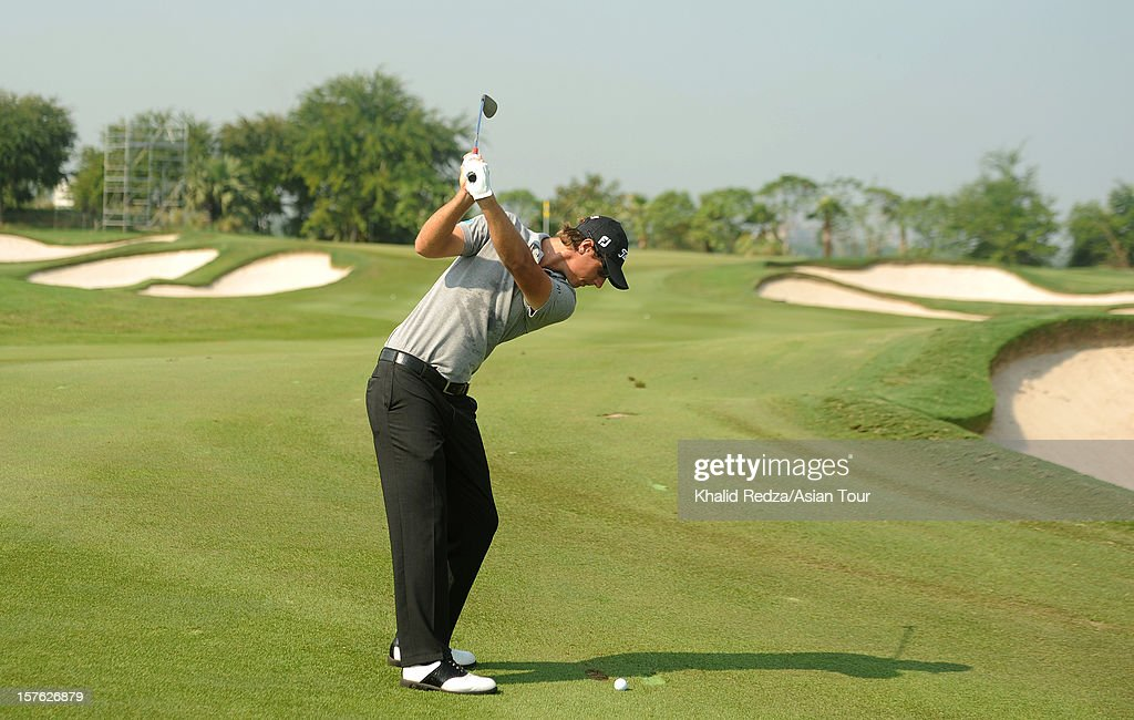 <a gi-track='captionPersonalityLinkClicked' href=/galleries/search?phrase=Nicolas+Colsaerts&family=editorial&specificpeople=216573 ng-click='$event.stopPropagation()'>Nicolas Colsaerts</a> of Belgium plays a shot ahead of the Thailand Golf Championship at Amata Spring Country Club on December 5, 2012 in Bangkok, Thailand.