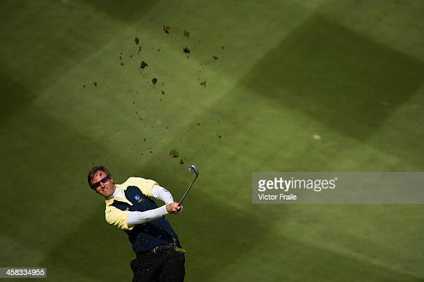 Nicolas Colsaerts of Belgium plays a shot on the 9th hole during the Royal Trophy Europe vs Asia Golf Championship at Dragon Lake Golf Club on...