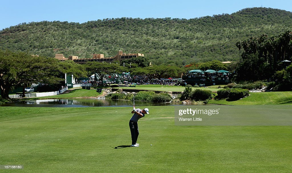 Nicolas Colsaerts of Belgium plays his second shot into the ninth green during the first round of the Nedbank Golf Challenge at the Gary Player Country Club on November 29, 2012 in Sun City, South Africa.