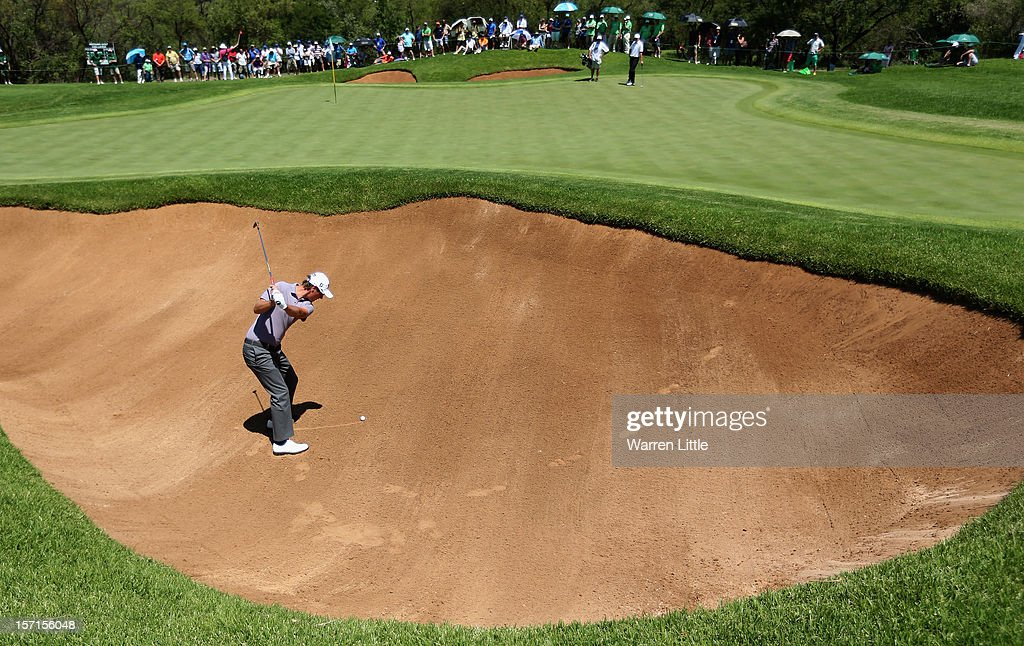 Nicolas Colsaerts of Belgium plays out of the eighth greenside bunker during the first round of the Nedbank Golf Challenge at the Gary Player Country Club on November 29, 2012 in Sun City, South Africa.