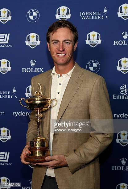 Nicolas Colsaerts of Belgium poses with the Ryder cup as the Europe team depart for the Ryder Cup from Heathrow Airport on September 24 2012 in...