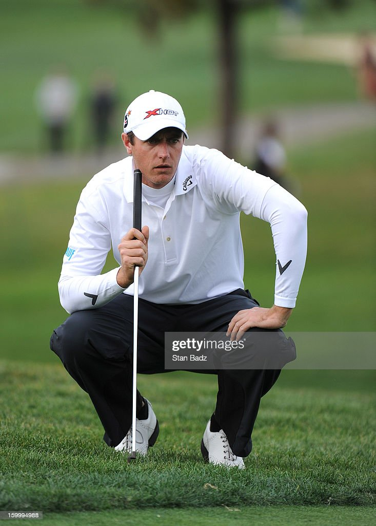 Nicolas Colsaerts of Belgium studies his putt on the ninth hole during the first round of the Farmers Insurance Open at Torrey Pines Golf Course on January 24, 2013 in La Jolla, California.