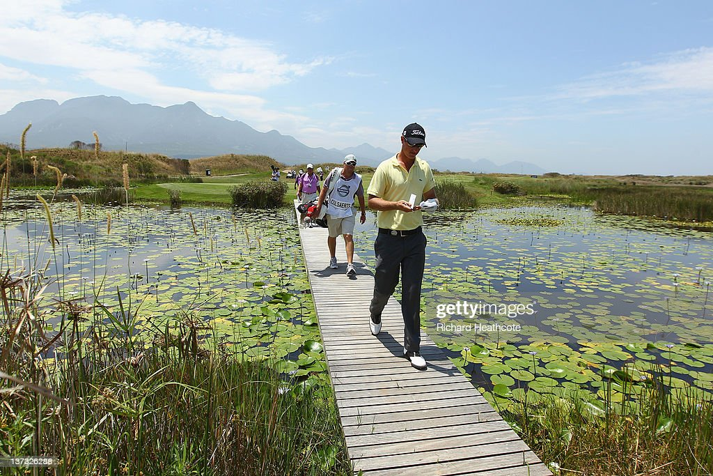 Nicolas Colsaerts of Belgium walks off the 15th green during the first round of the Volvo Golf Champions at The Links at Fancourt on January 19 2012...