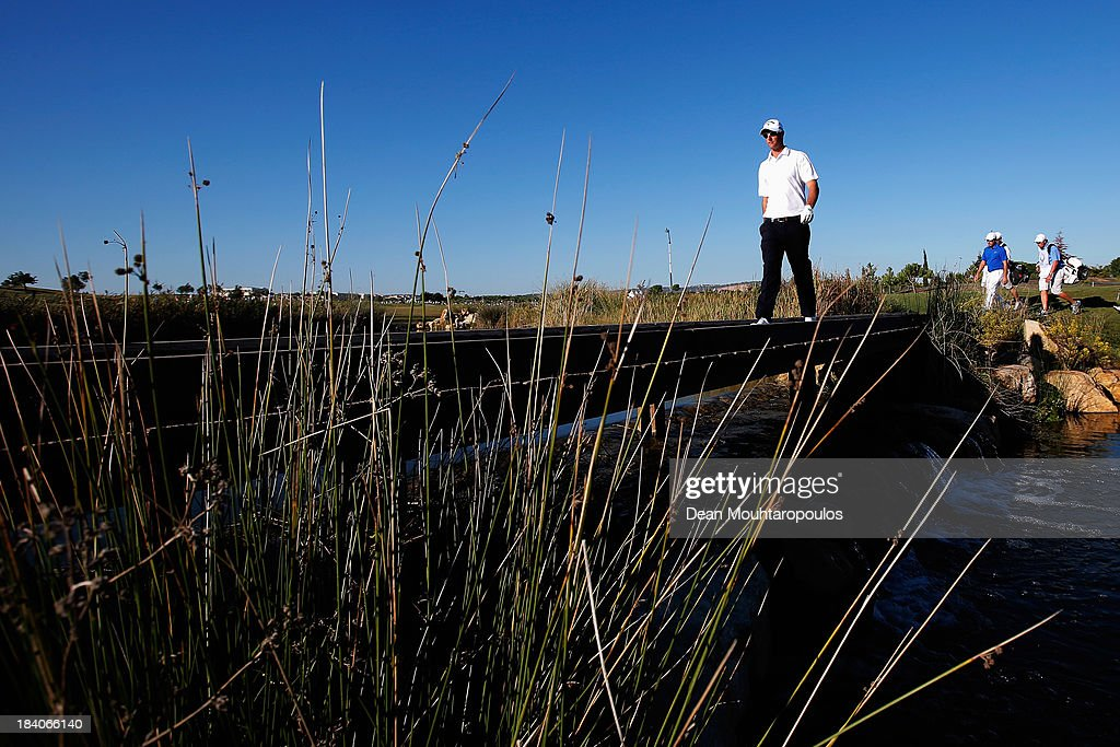 <a gi-track='captionPersonalityLinkClicked' href=/galleries/search?phrase=Nicolas+Colsaerts&family=editorial&specificpeople=216573 ng-click='$event.stopPropagation()'>Nicolas Colsaerts</a> of Belgium walks on a bridge after he hits his tee shot on the 17th hole during the second round of the Portugal Masters at Oceanico Victoria Golf Course on October 11, 2013 in Faro, Portugal.