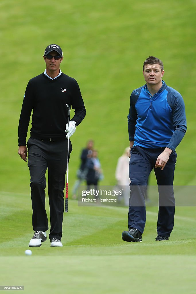 Nicolas Colsaerts of Belgium walks with Brian O'Driscoll during the Pro-Am prior to the BMW PGA Championship at Wentworth on May 25, 2016 in Virginia Water, England.