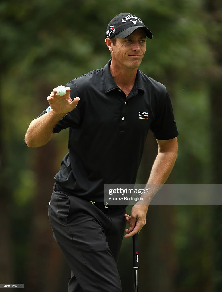 Nicolas Colsaerts of Belgium waves to the crowd after his birdie on the eighth hole during the first round of the 72nd Open d'Italia at Golf Club...