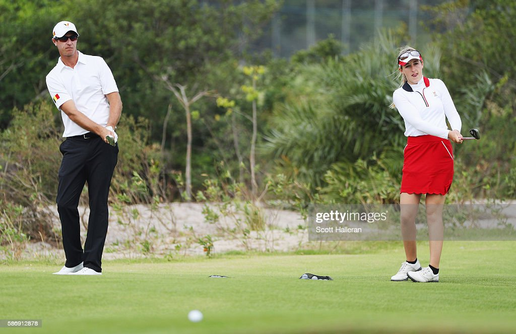 Nicolas Colsarts (L) and Chloe Leurquin of Belgium work on the range during a practice round during Day 2 of the Rio 2016 Olympic Games at Olympic Golf Course on August 7, 2016 in Rio de Janeiro, Brazil.
