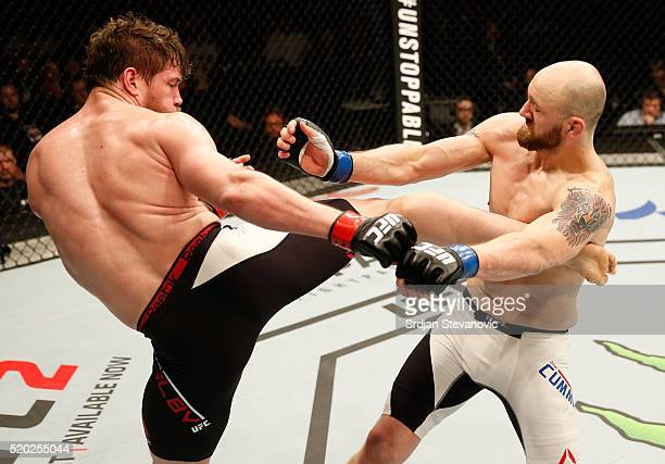 Nicolas Dalby kicks Zak Cummings in their welterweight bout during the UFC Fight Night event at the Arena Zagreb on April 10 2016 in Zagreb Croatia
