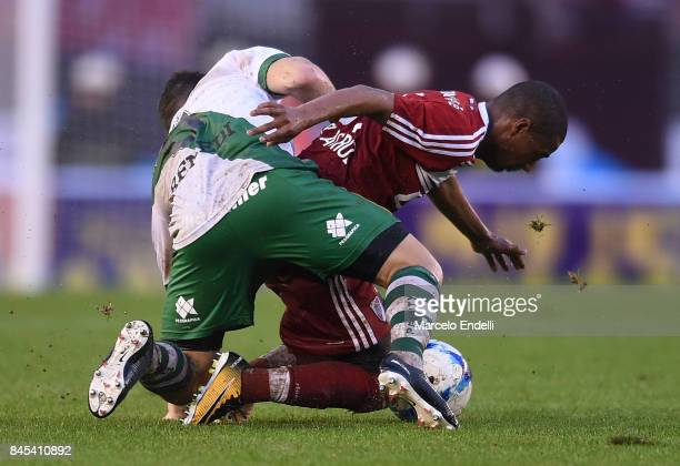 Nicolas De La Cruz of River Plate fights for the ball with Eric Remedi of Banfield during a match between River Plate and Banfield as part of...