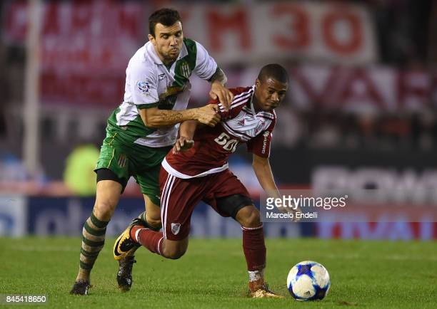 Nicolas De La Cruz of River Plate fights for the ball with Nicolas Bertolo of Banfield during a match between River Plate and Banfield as part of...