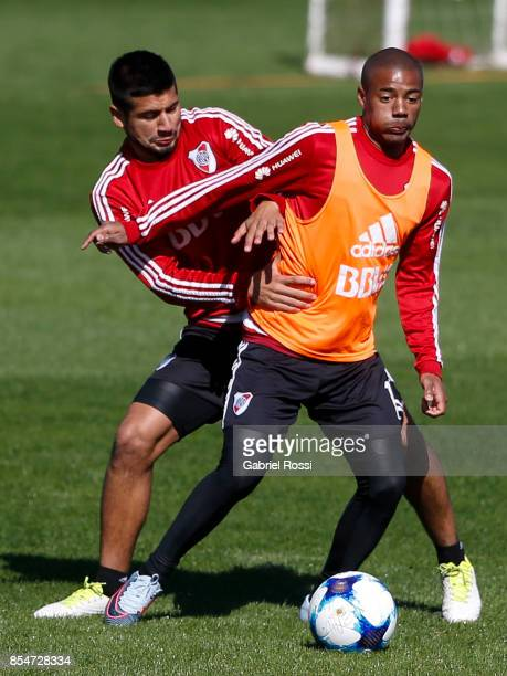Nicolas De la Cruz of River Plate fights for the ball with teammate Zacarias Moran Correa during a training session at River Plate's training camp on...