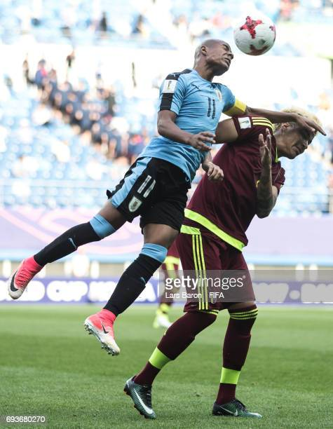 Nicolas de la Cruz of Uruguay goes up for a header with Adalbert Penaranda of Venezuela during the FIFA U20 World Cup Korea Republic 2017 Semi Final...