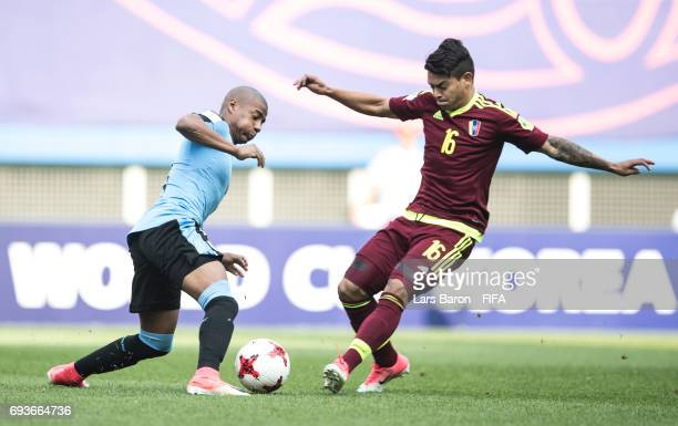 Nicolas de la Cruz of Uruguay is challanged by Samuel Sosa of Venezuela during the FIFA U20 World Cup Korea Republic 2017 Semi Final match between...