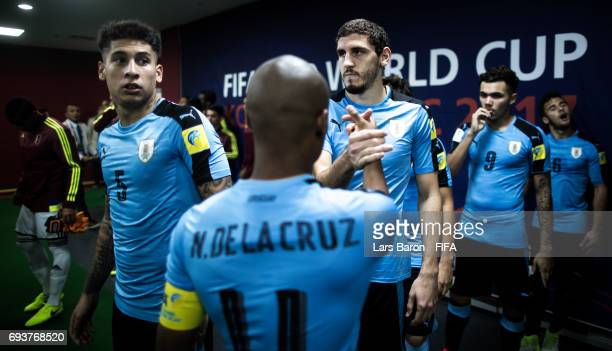 Nicolas de la Cruz of Uruguay shakes hands with Agustin Rogel of Uruguay during the FIFA U20 World Cup Korea Republic 2017 Semi Final match between...
