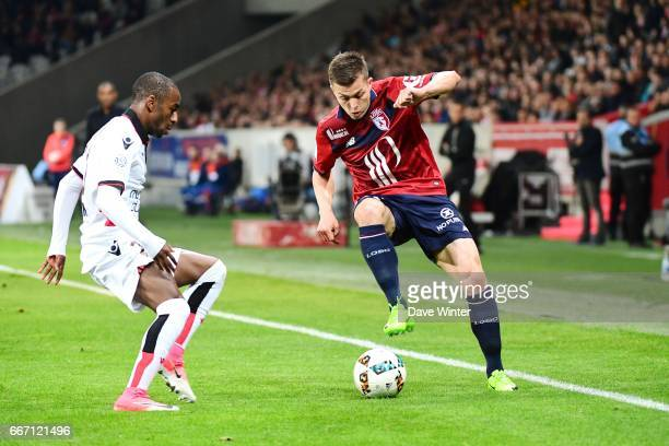 Nicolas De Preville of Lille and Dalbert Henrique of Nice during the French Ligue 1 match between Lille OSC and OGC Nice at Stade PierreMauroy on...