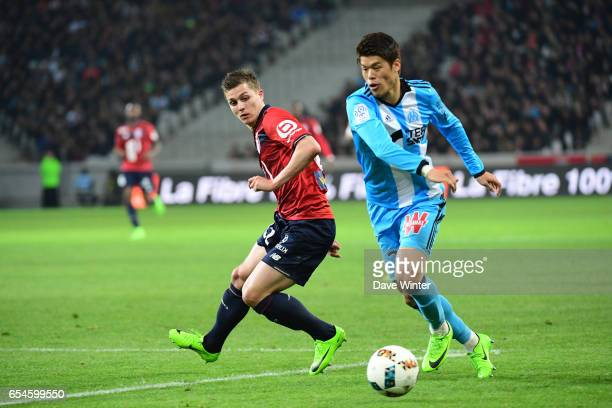 Nicolas De Preville of Lille and Hiroki Sakai of Marseille during the Ligue 1 match between Lille OSC and Olympique de Marseille at Stade Pierre...