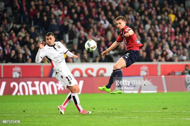 Nicolas De Preville of Lille and Valentin Eysseric of Nice during the French Ligue 1 match between Lille OSC and OGC Nice at Stade PierreMauroy on...