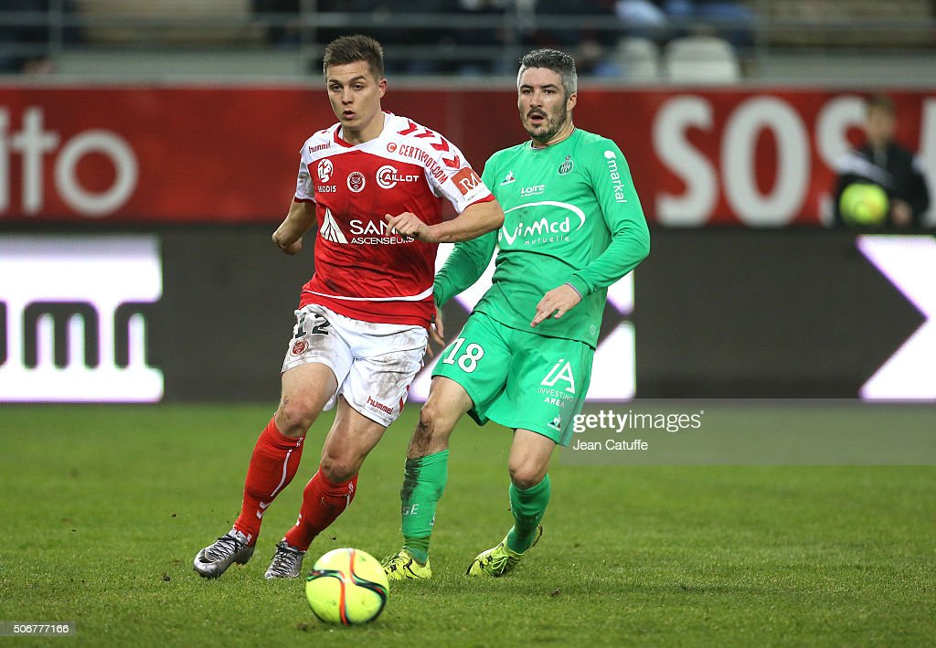 Nicolas de Preville of Stade de Reims and <a gi-track='captionPersonalityLinkClicked' href=/galleries/search?phrase=Fabien+Lemoine&family=editorial&specificpeople=4784581 ng-click='$event.stopPropagation()'>Fabien Lemoine</a> of Saint-Etienne in action during the French Ligue 1 match between Stade de Reims and AS Saint-Etienne (ASSE) on January 24, 2016 in Reims, France.