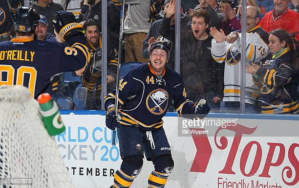 Nicolas Deslauriers of the Buffalo Sabres celebrates his first period goal against the Ottawa Senators with teammate Ryan O'Reilly during an NHL game...