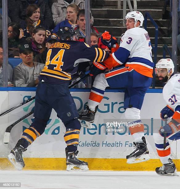 Nicolas Deslauriers of the Buffalo Sabres checks Travis Hamonic of the New York Islanders on February 8 2015 at the First Niagara Center in Buffalo...