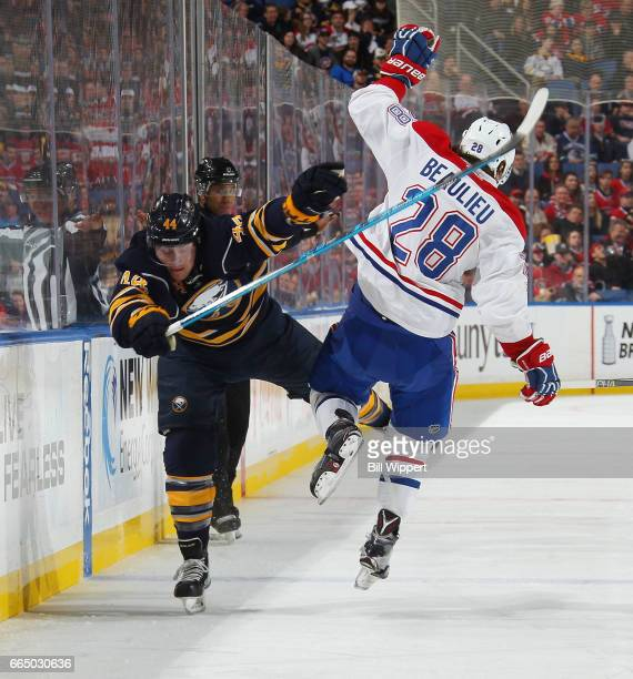 Nicolas Deslauriers of the Buffalo Sabres collides along the boards with Nathan Beaulieu of the Montreal Canadiens during an NHL game at the KeyBank...