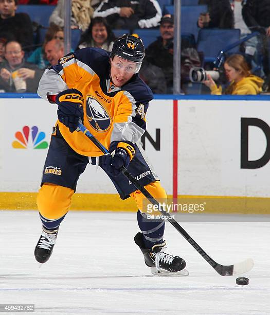 Nicolas Deslauriers of the Buffalo Sabres passes the puck against the San Jose Sharks on November 18 2014 at the First Niagara Center in Buffalo New...