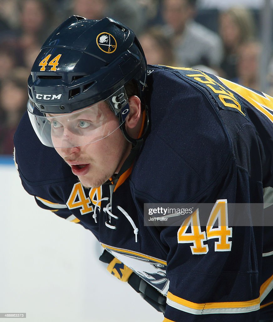 Nicolas Deslauriers #44 of the Buffalo Sabres prepares for a face-off against the New York Islanders at First Niagara Center on April 13, 2014 in Buffalo, New York.