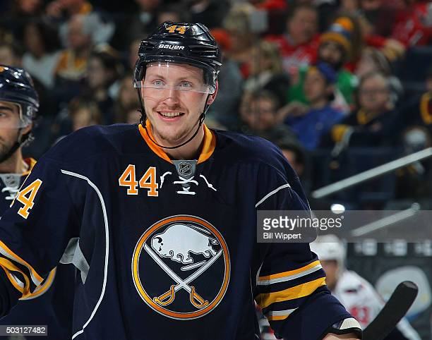 Nicolas Deslauriers of the Buffalo Sabres smiles as he prepares for a faceoff against the Washington Capitals during an NHL game on December 28 2015...