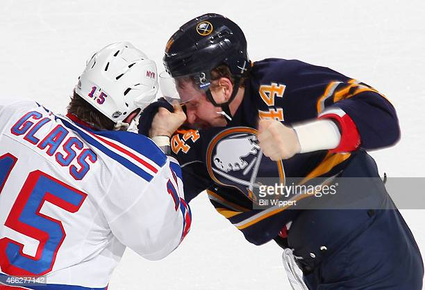 Nicolas Deslauriers of the Buffalo Sabres tangles with Tanner Glass of the New York Rangers during the second period of their game on March 14 2015...