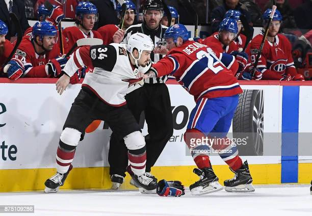 Nicolas Deslauriers of the Montreal Canadiens fights against Zac Rinaldo of the Arizona Coyotes in the NHL game at the Bell Centre on November 16...