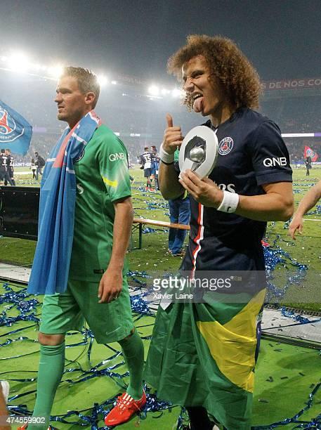 Nicolas Douchez and David Luiz of Paris SaintGermain react and celebrates winning the championship after the French Ligue 1 game between Paris...