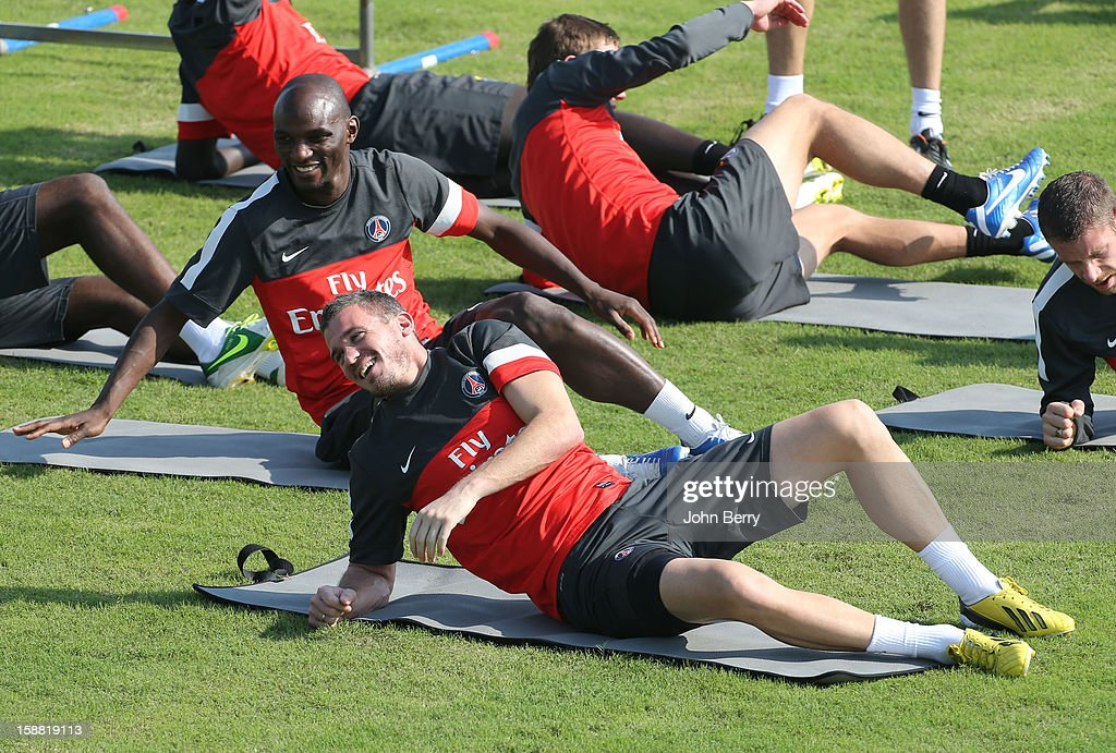 Nicolas Douchez and Zoumana Camara of PSG warm up during the Paris Saint Germain training session held at the Aspire Academy for Sports Excellence on December 30, 2012 in Doha, Qatar.