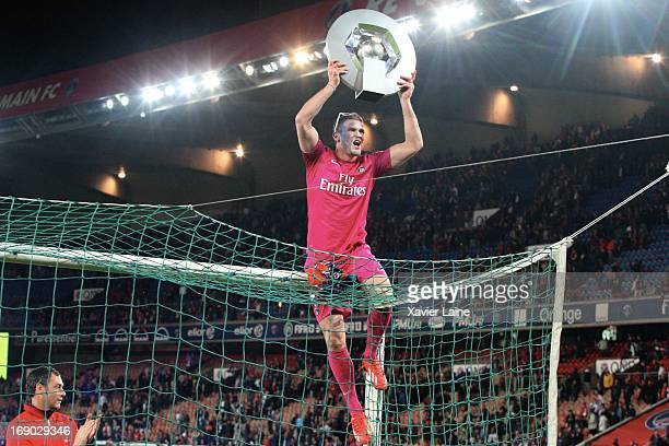 Nicolas Douchez of Paris SaintGermain celebrate after defeating Stade Brestois 29 at the French League 1 match at Parc des Princes on May 18 2013 in...