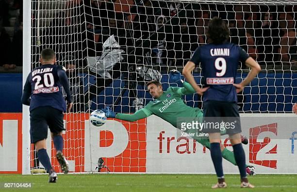 Nicolas Douchez of Paris SaintGermain stops a penalty shot during the French League Cup semifinal between Paris SaintGermain and Toulouse FC at Parc...
