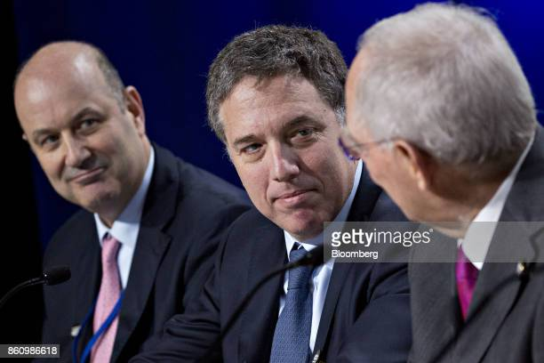 Nicolas Dujovne Argentina's treasury minister center and Federico Sturzenegger president of the Central Bank of Argentina left listen as Wolfgang...