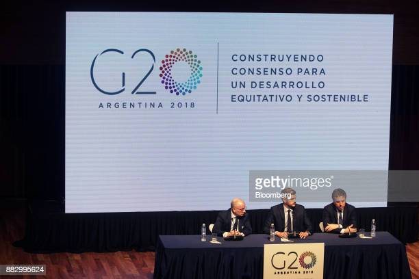 Nicolas Dujovne Argentina's treasury minister left speaks while Jorge Faurie Argentina's foreign affairs minister left and Marcos Pena Argentina's...